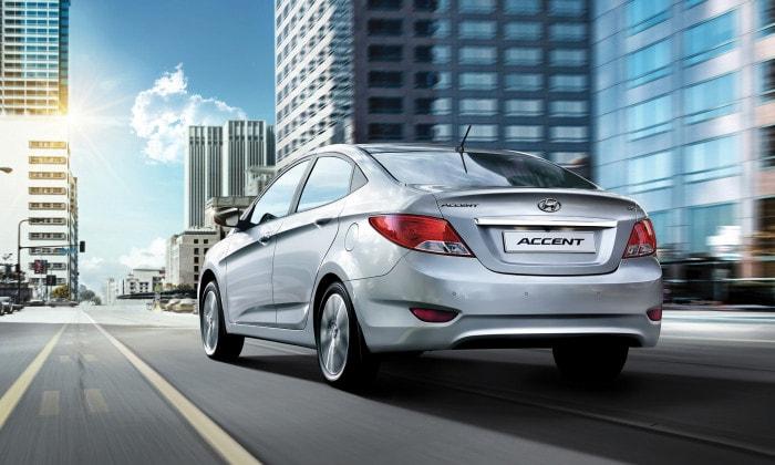 A silver Hyundai rental car driving in Perth.